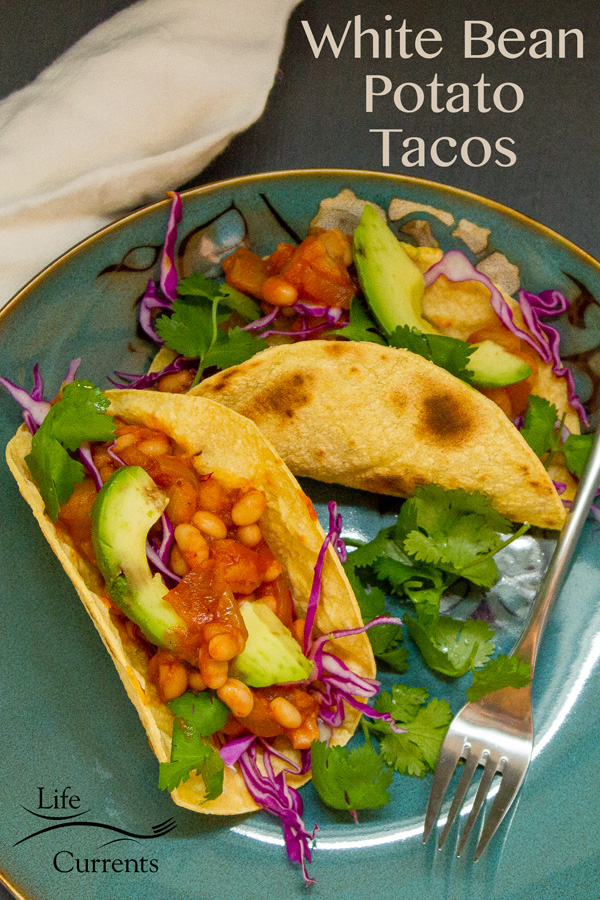 White Bean - Potato Tacos are super yummy, with a hint of smoky chipotle. The sauce is well-rounded with sweet and tangy white onions, tomato paste, and a little sugar. And, they have that creaminess that potatoes and white beans give. Just all around a perfect taco filling!