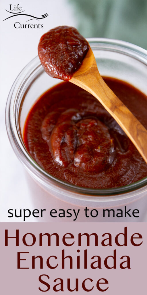a small wooden spoon with sauce in it, on top of a jar of enchilada sauce, title under image