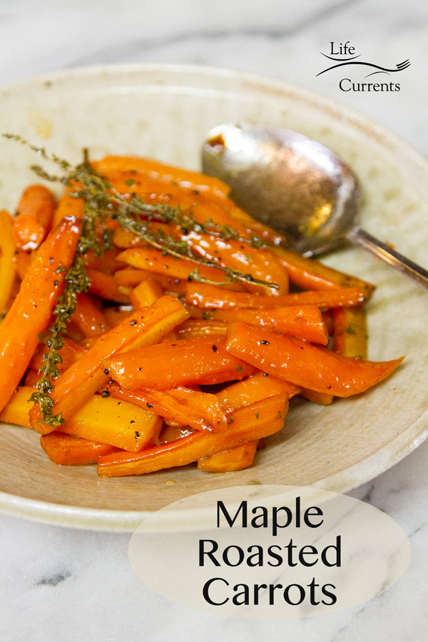 Maple Roasted Carrots on a serving plate with a spoon, garnished with thryme sprigs, title on bottom