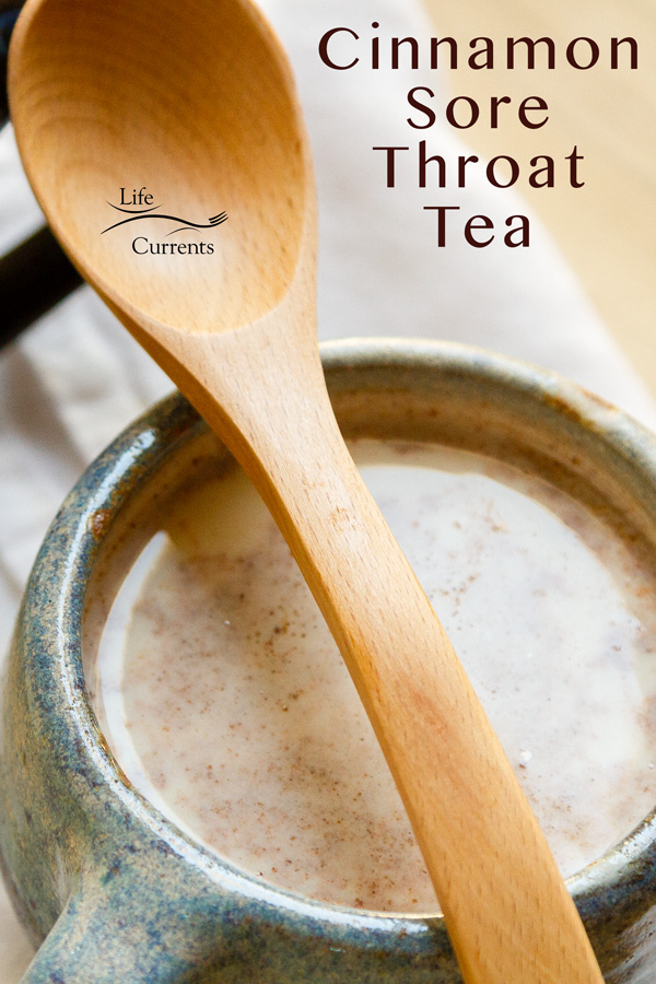 Cinnamon Sore Throat Tea in a blue mug with a wooden spoon on top, title on the right