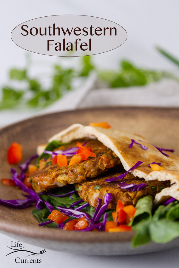 Southwestern Falafel in a pita with lettuce, cabbage, red pepper on a brown plate with fresh cilantro in the background. Title on image