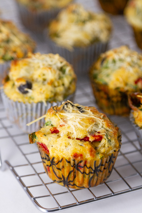 muffins in paper cups on a cooling rack.