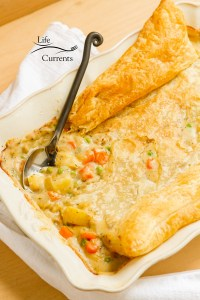 Mom's Vegetarian Pot Pie in a casserole dish with a serving spoon