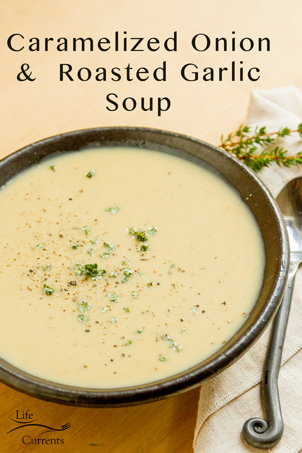Caramelized Onion Roasted Garlic Bisque in a black bowl with a spoon at the title on the image