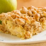 Apple Crumb Cake - Soft vanilla butter cake with a cinnamon crumble topping and tart yummy apple chunks inside. It's the perfect cake. Not too sweet, not dry at all. Full of flavor. This is the kind of cake you want to make again and again.