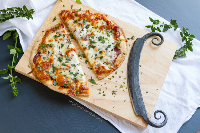 Beer and Pizza Night with a recipe for Easy Garlic and Herb Pizza - Steel Pizza Cutter
