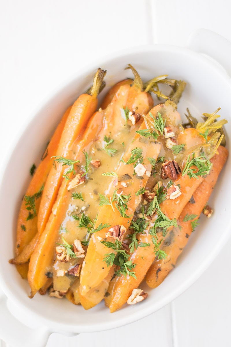 Easy Crock Pot (Slow Cooker) Meals - Crockpot orange, honey and herb glazed carrots from Culinary Ginger