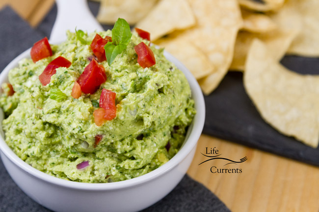 Mediterranean Avocado Feta Dip - Smooth and creamy, this Mediterranean Avocado Feta Dip is filled with wonderful earthy basil and salty feta cheese. This dip will be welcome at your next party!