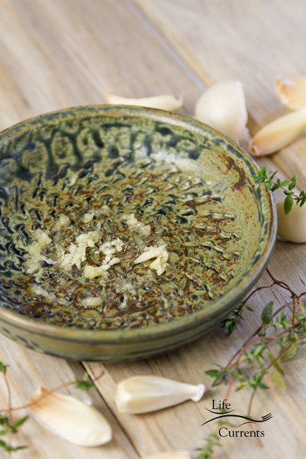 Garlic Butter Dipping Sauce I used my favorite little French style garlic grater to grate and serve the sauce.