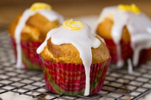 Lemon Glazed Sugar Muffins -Lemon glaze dripping over sugar muffins waiting to be grabbed