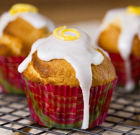 Lemon Glazed Sugar Muffins -Lemon glaze dripping over sugar muffins waiting to be grabbed