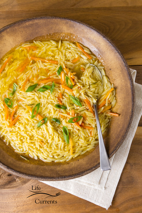 Rosemary Orzo Soup - It's easy. It's delicious. And, it's a healthy meal. And, one that I can add in a bunch of veggies if I want. vertical image with spoon