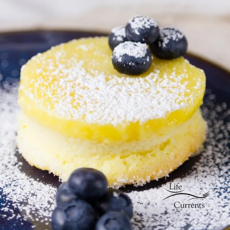 These Lemon Soufflé Magic Cakes are light and airy sponge cakes topped with a lemon curd pudding. And, all you had to do was make one batter that magically separates while it bakes!