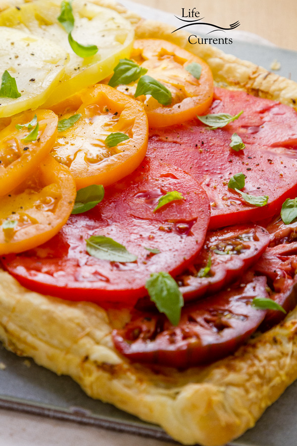 Ombre Heirloom Tomato Ricotta Tart An easy to make vegetarian tart that makes an impressive looking appetizer, light lunch, or brunch offering.