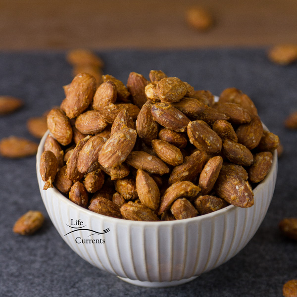 a bowl full of flavored almonds
