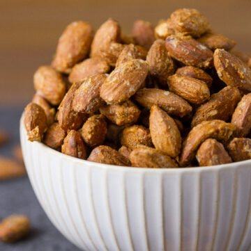 """These Smoked Garlic Almonds are the bomb tailgating snack! Like """"make a batch, sit down with a beer and these and watch the game while noshing away"""" snack!"""