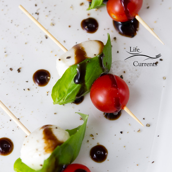 appetizer Skewers with tomatoes, basil, mozzarella and balsamic glaze