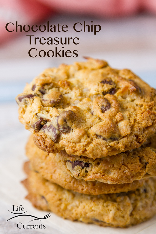 These easy to make, fun chewy Chocolate Chip Treasure Cookies are loaded with goodies like graham cracker crumbs, sweetened condensed milk, coconut, almonds, and of course, chocolate chips!