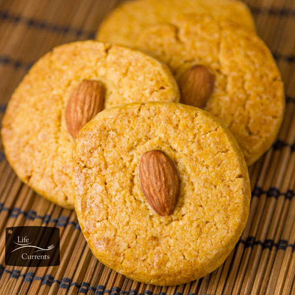 delicious & traditional Chinese Almond Cookies are dense, sandy, and crunchy. I much prefer the Chinese Almond Cookie to the more popular fortune cookie at the end of the meal!
