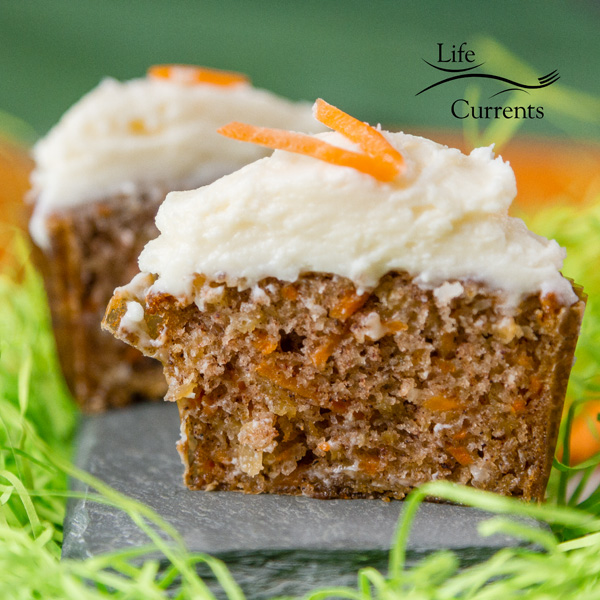 Carrot Cake Cupcakes with Cream Cheese Frosting cup in half so you can see the tender cake inside