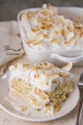 Toasted Coconut Ice Box Cake -- A easy to make, no-bake ice box cake that's filled to the brim with delicious coconut – from coconut milk, shredded coconut, coconut cookies, and coconut chips. If you're a coconut fan, this is for you!