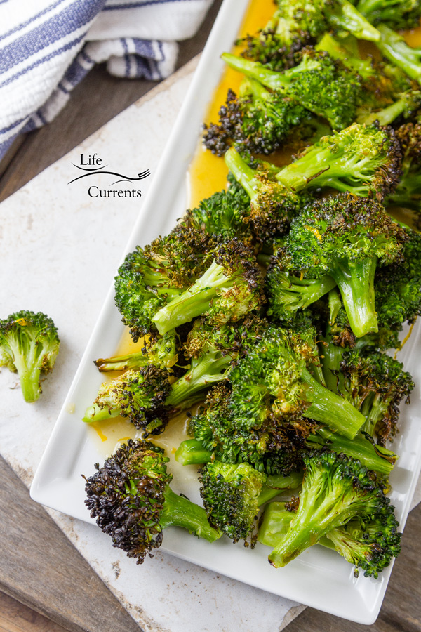 Honey Orange Roasted Broccoli - Nicely roasted bites of broccoli with slightly bitter edges bathed in a sweet honey orange sauce.