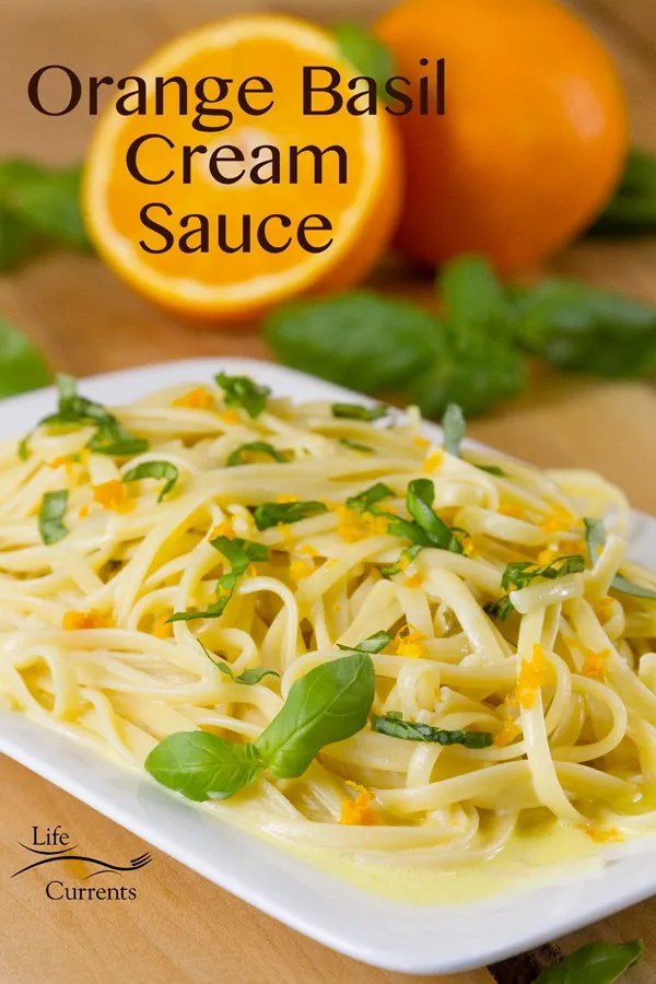 Orange Basil Cream Sauce - An unforgettable buttery cream sauce with sweet tangy orange and fresh basil. Here I've served it over pasta