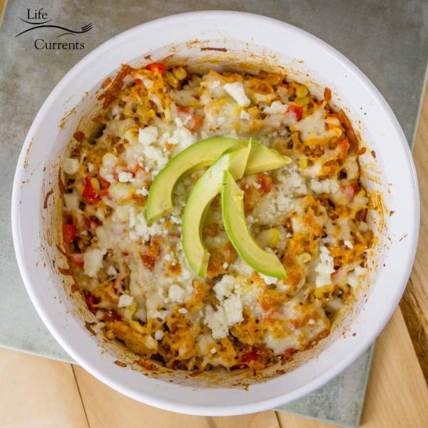 Cheesy Spanish Rice Casserole Recipe - Super easy to make, and really delicious, this Mexican flavored rice casserole is a hit with my family.