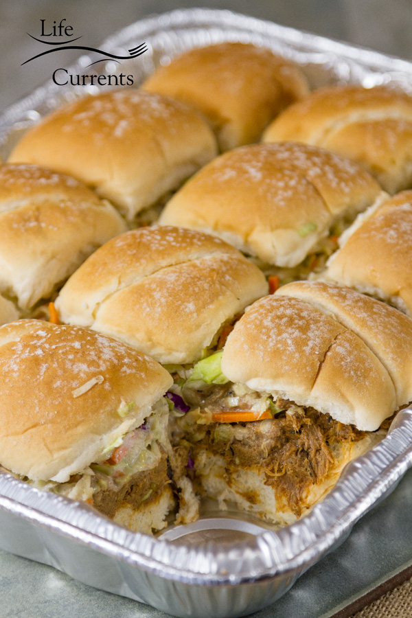 These Pulled Pork Sliders with Ranch Coleslaw will be a hit at your next picnic, pool party, or summer gathering.