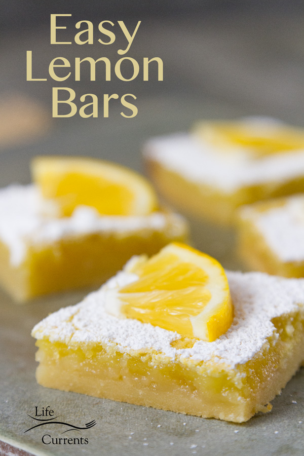 Lemon Bars - A light buttery shortbread crust covered with tangy sweet lemon curd, and simply topped with powdered sugar.