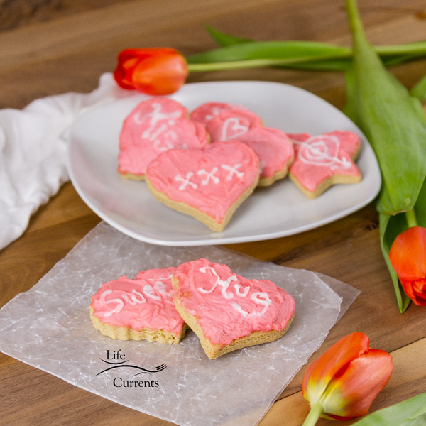 Every year for Valentine's Day my mom makes these Cut Out Cookies. Then she frosts them with Aunt Lois' Frosting. And she's sweet enough to share these frosted cut out cookies with me.