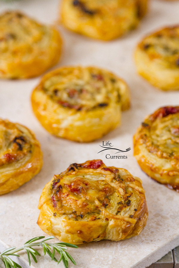 Pesto Puff Pastry Pinwheels with Sun Dried Tomatoes and Roasted Red Peppers make a great light lunch or after work or school snack.