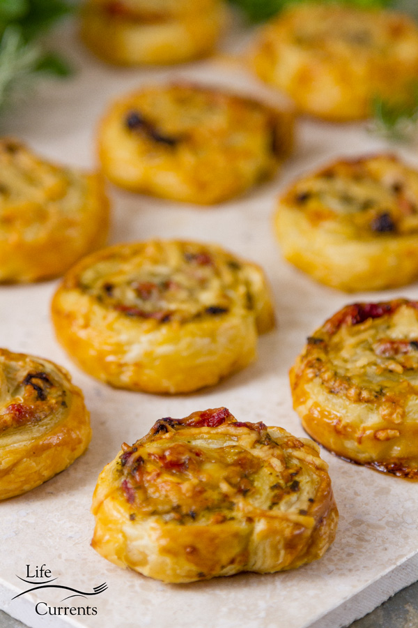 Pesto Puff Pastry Pinwheels with Sun Dried Tomatoes and Roasted Red Peppers easy to make and delicious Italian Mediterranean party snack foods