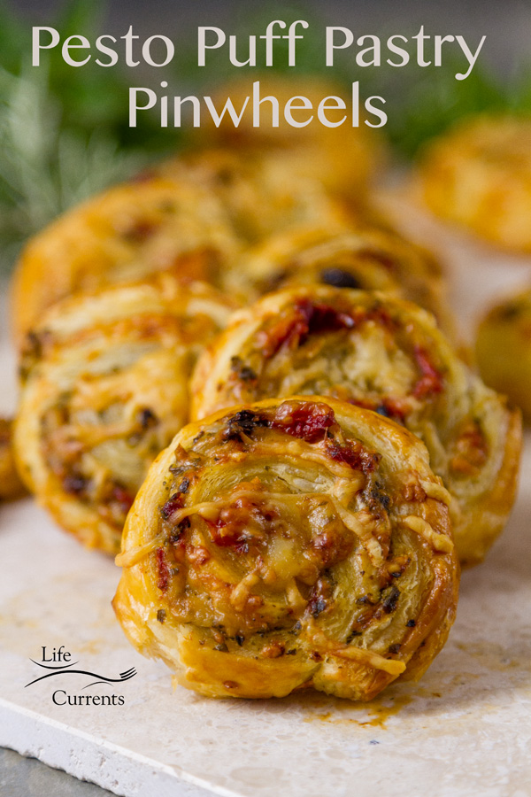 Pesto Puff Pastry Pinwheels are super easy to make pinwheel appetizers with basil pesto, roasted red peppers, sun dried tomatoes, and Parmesan cheese.