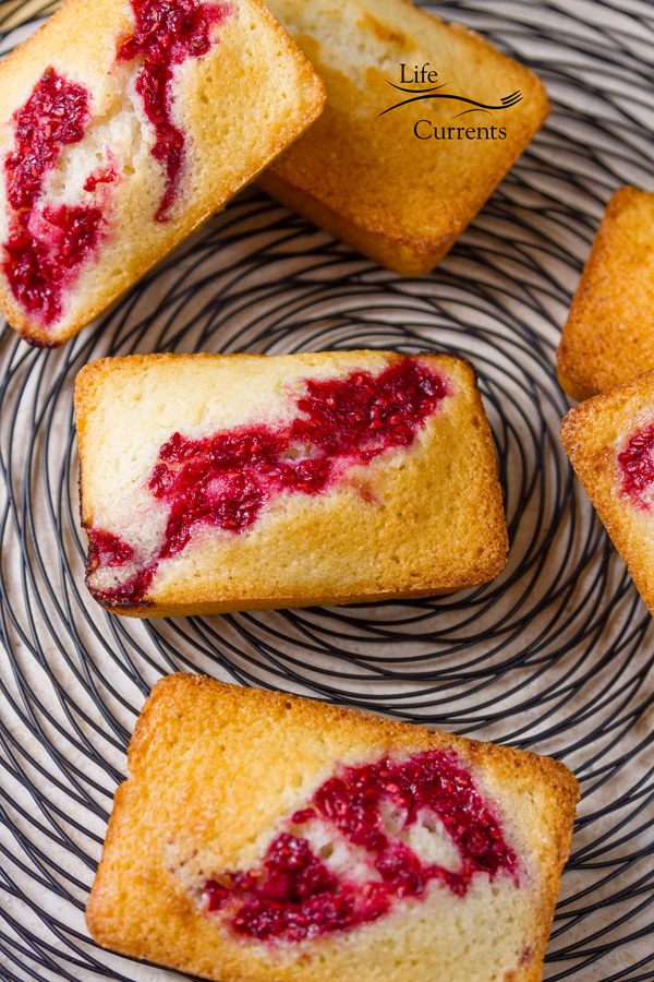 French Almond Financiers Cakes Recipe with Roasted Raspberry Swirl on a wire rack for serving