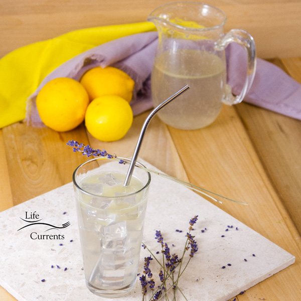 Square image of Lemonade with lemons in the background