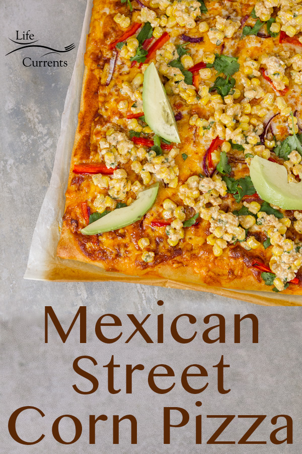 Mexican Street Corn Pizza - Creamy, tangy, sweet, Mexican street corn will tantalize your taste buds, especially when it's added to a pizza made with delicious enchilada sauce, lots of cheese, and just the right Mexican-style pizza toppings.