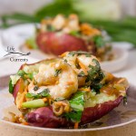 two servings of Thai Basil Shrimp stuffed in sweet potatoes