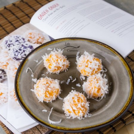 Rice. Noodles. Yum. open to page 175 for the recipe of Sweet Potato Rice Balls with the dessert treats on a gray plate on top of the book