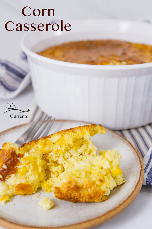corn casserole a serving in front and the whole dish in the back