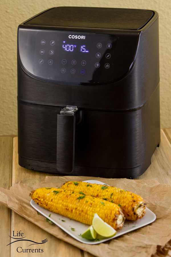 The new COSORI Smart WiFi Air Fryer 5.8QT and two ears of roasted corn