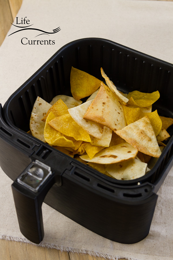 tortilla chips in the basket of the air fryer