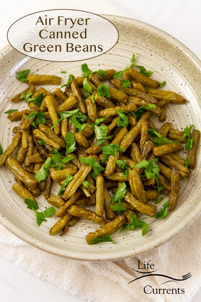 cooked green beans garnished with fresh parsley on a plate, title on image: Air Fryer Canned Green Beans