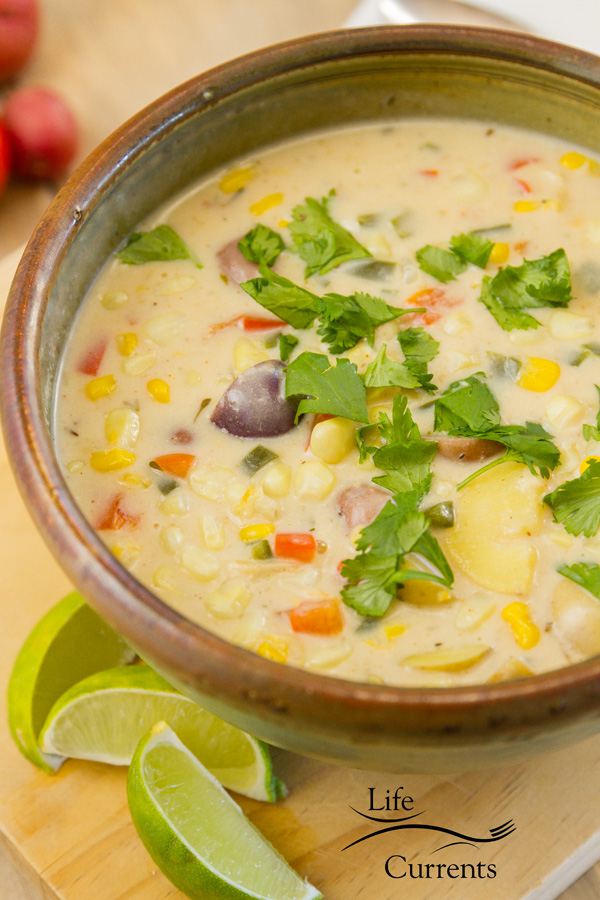 Southwestern Corn Chowder in a cermaic bowl with lime wedges