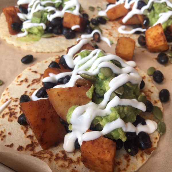 sweet potato and black bean tacos with sour cream and guacamole