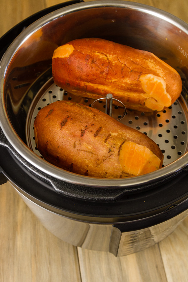 two sweet potatoes in a pressure cooker