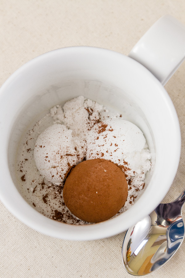 Place the cocoa and the powdered sugar in the bottom of the mug, and mix together thoroughly.