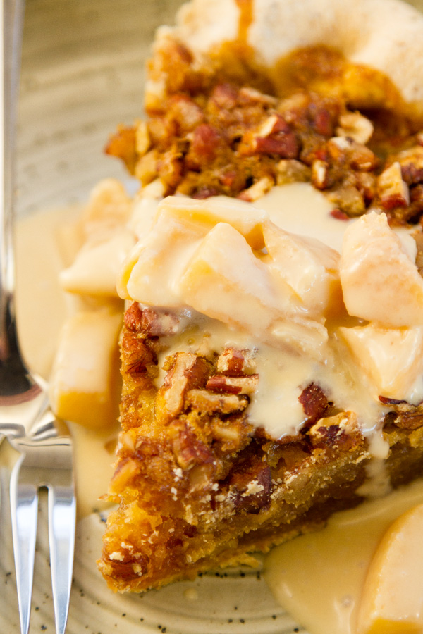 pecan pie with Peach Caramel Cream Sauce over it