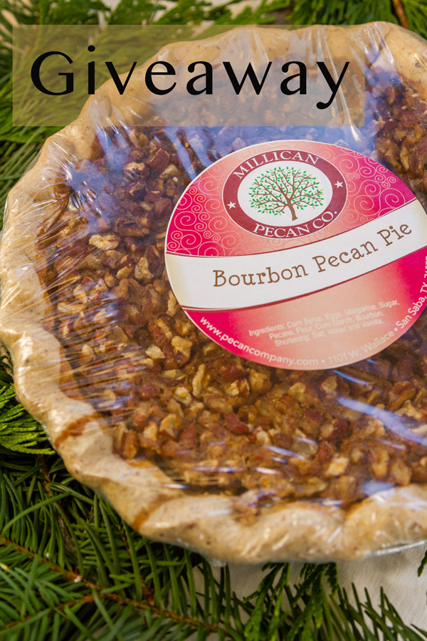 Bourbon Pecan Pie in the wrapper with some fir tree branches and a giveaway title