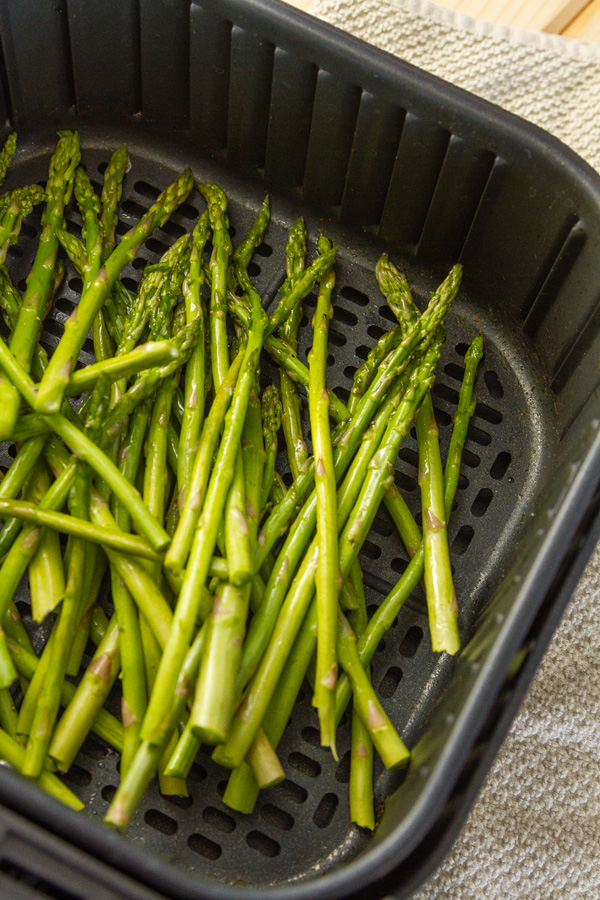 asparagus in the basket of an air fryer